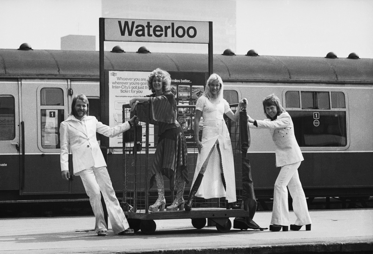 ABBA posing at Waterloo railway station.