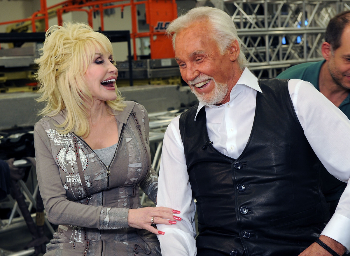 "Dolly Parton and Kenny Rogers backstage at ""Kenny Rogers: The First 50 Years"" at the MGM Grand at Foxwoods on April 10, 2010, in Ledyard Center, Connecticut."