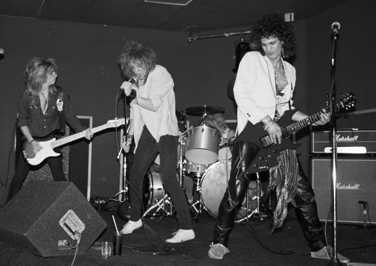 (L-R) Steve Darrow, Axl Rose, Steven Adler (behind the drums) and Slash performing as Hollywood Rose at Madame Wong's East on June 28, 1984, in Los Angeles, California.