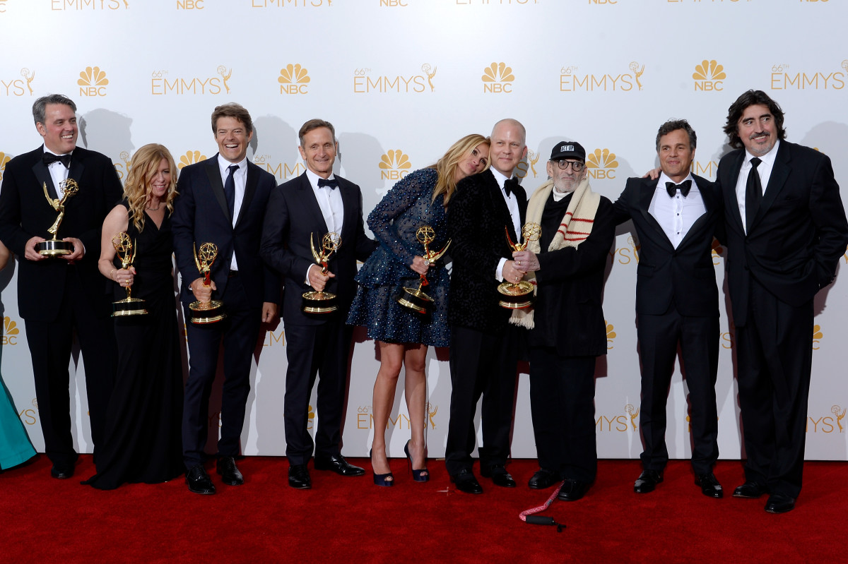 "The cast and crew of ""The Normal Heart"" after their win for Outstanding Television Movie at the 66th Annual Primetime Emmy Awards (L-R) Producers Ned Martel, Dede Gardner, executive producers Jason Blum, Dante Di Loreto, actress Julia Roberts, producer/director Ryan Murphy, writer Larry Kramer, actors Mark Ruffalo, and Alfred Molina"