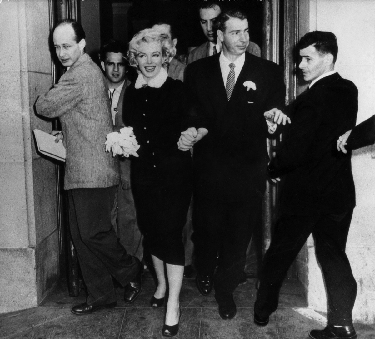 Marilyn Monroe and Joe DiMaggio leaving the town hall after their wedding on January 14, 1954, in San Francisco, California