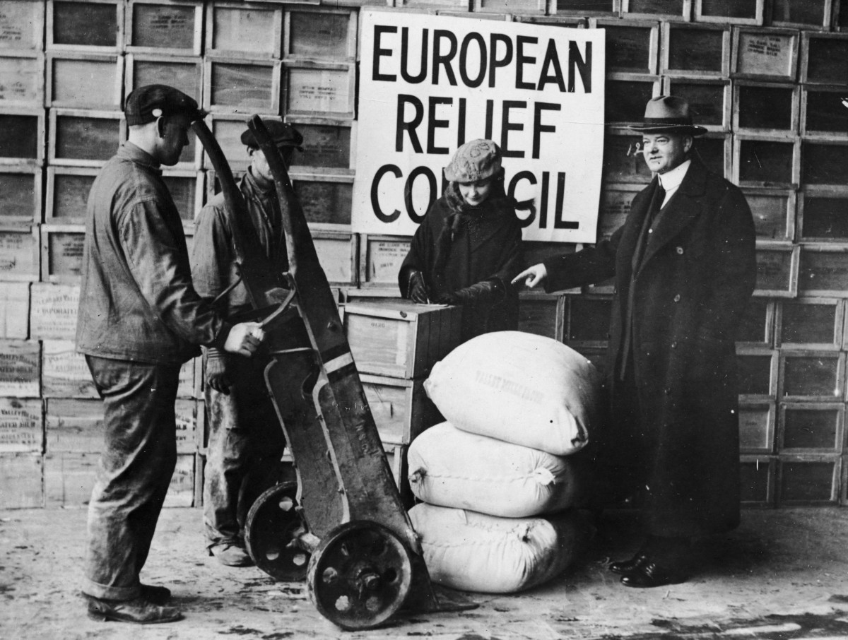 Herbert Hoover overseeing the shipping of relief supplies to post-war Europe from the Bush Docks in Brooklyn, New York.