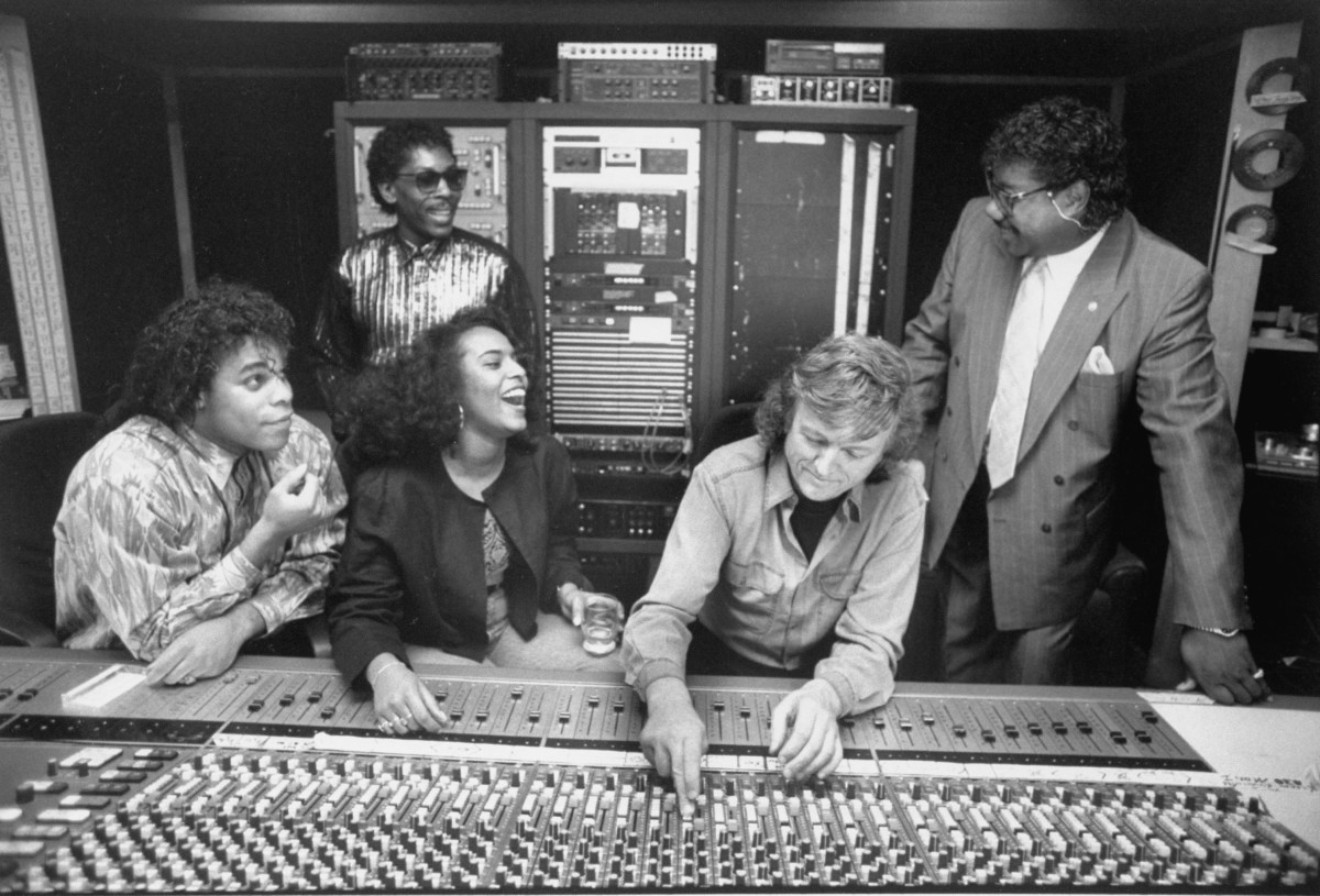 Brad Howell (R) & John Davis (2L), who lip-synced for the fakes, w. Gina Mohammed (3L), Ray Horton (L) and their producer Frank Farian (2R) posing at control board in recording studio