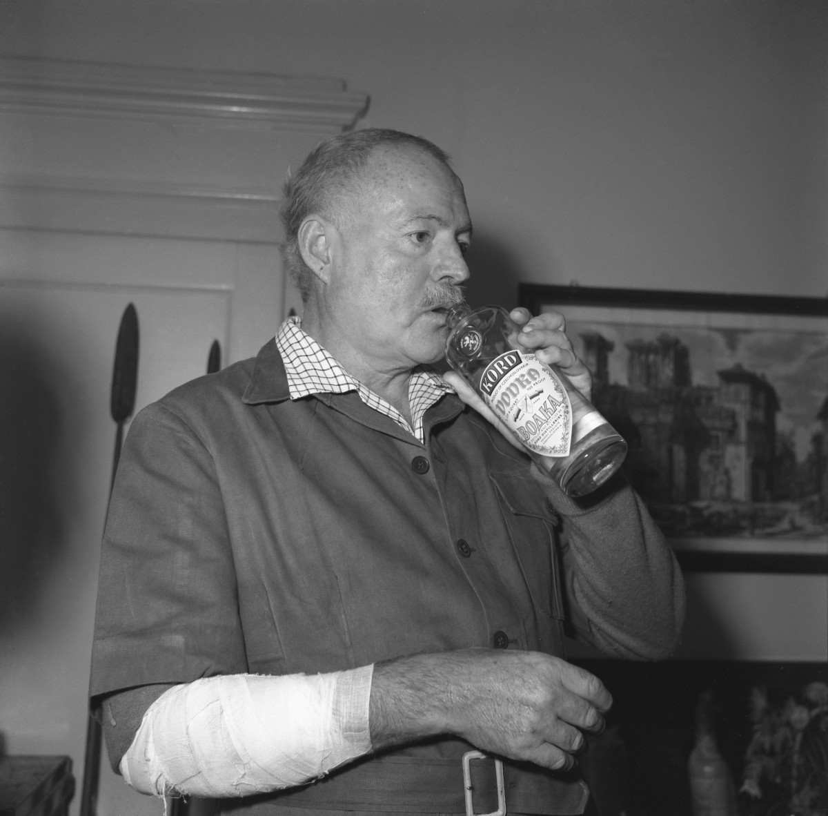 Ernest Hemingway, wearing drinking vodka from the bottle, Venice 1954