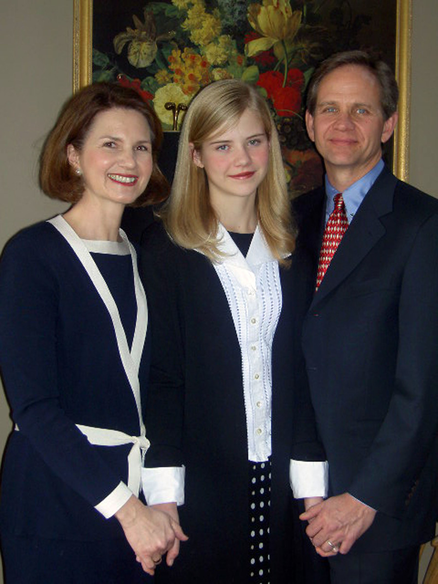 Elizabeth Smart poses for a portrait with her parents, Ed and Lois, at their home on February 22, 2004, in Salt Lake City, Utah