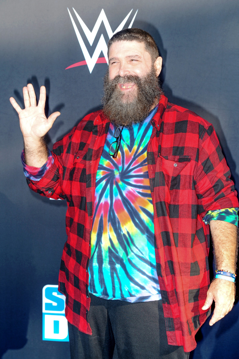 Mick Foley in 2019 wearing a tie-dye shirt like his character, Dude Love